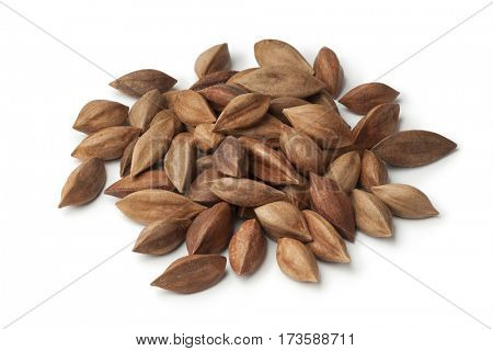 Heap of unshelled pili nuts from the Philippines on white background