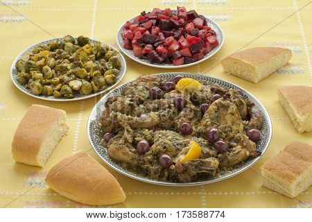 Moroccan meal with chicken, brussels sprouts, beet salad and bread