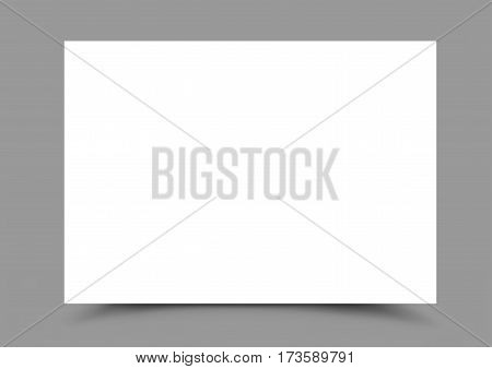 A4 white horizontal paper for note, message, drawing with the shadow bottom on gray background. Advertising template