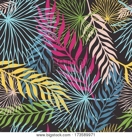 Pattern of colored tropical leaves. On a black background. Seamless.