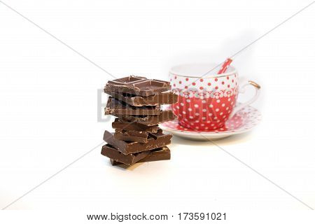 polka dot cup and chocolat isolated on white