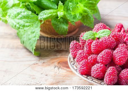 Ripe Sweet Raspberries In Bowl On Wooden Table, Closeup.