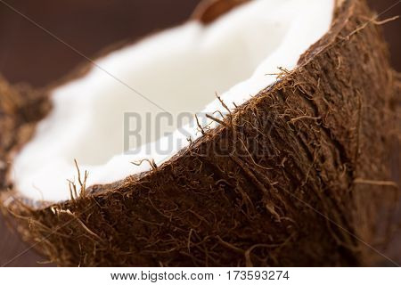 Half Of Ripe Coconut On Wooden Background