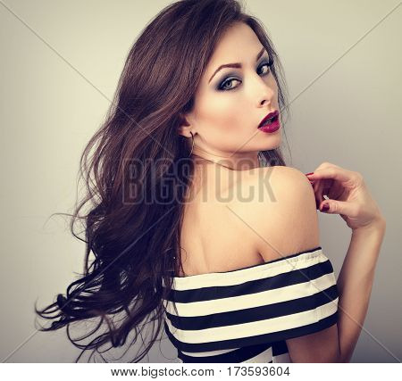 Beautiful Sexy Young Make-up Model Posing  With Streaming, Fly Away Brown Hair. Long Hairstyle And R