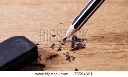 Eraser and error concept Black pencil with black eraser Mistake erase concept