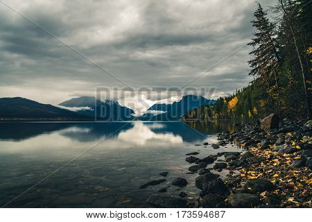 Image of a calm lake on an autumn afternoon.