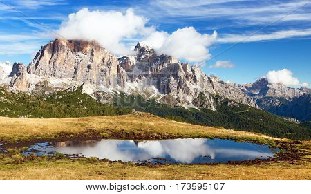 View from passo Giau Tofana or Le Tofane Gruppe mountain mirroring in lake Dolomites Italy