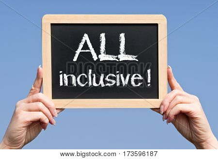 ALL inclusive - female hands holding chalkboard with text