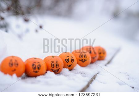 Tangerines With Different Funny Facial Expressions