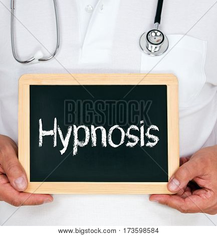 Hypnosis - Doctor holding chalkboard with text