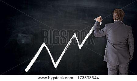 Business man writes index on blackboard concept.