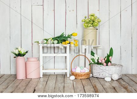 Vintage easter decoration with eggs and tulip flowers.
