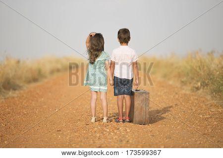 Pair of children on a dirt road in Guadalajara, Spain