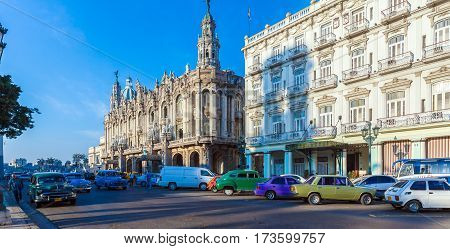 Havana, Cuba - April 2, 2012: Two Vintage Cars  In Front Of Great Theater