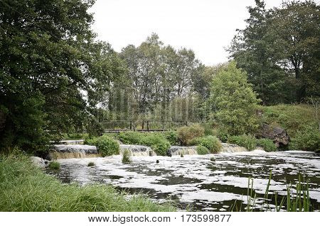 small waterfall in the belarus forest nature