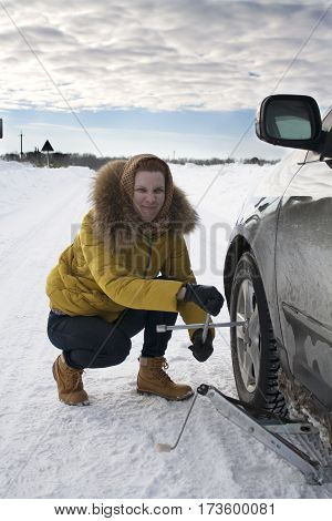 Girl stopped on the road and your car repairs