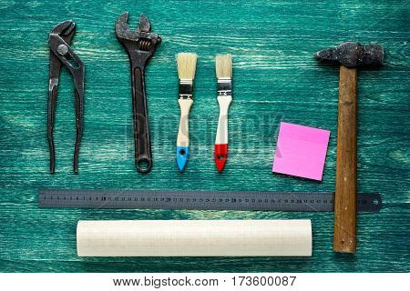 Assorted work tools on wooden background. Top wiew.