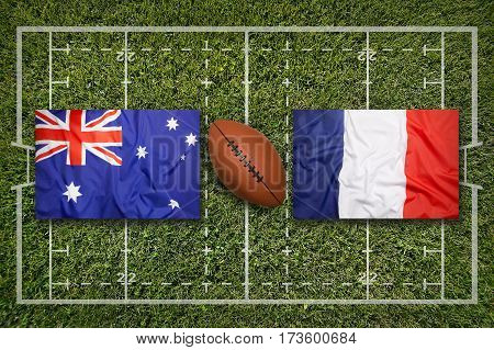 Australia vs. France flags on green rugby field, 3 D illustration