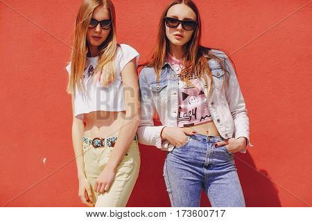 beautiful models pose for a photo in trendy clothes