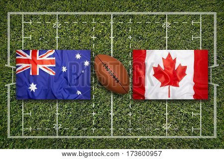Australia vs. Canada flags on green rugby field, 3 D illustration