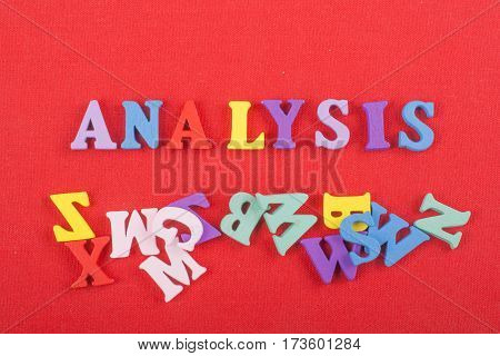 Word on red background composed from colorful abc alphabet block wooden letters copy space for ad text. Learning english concept