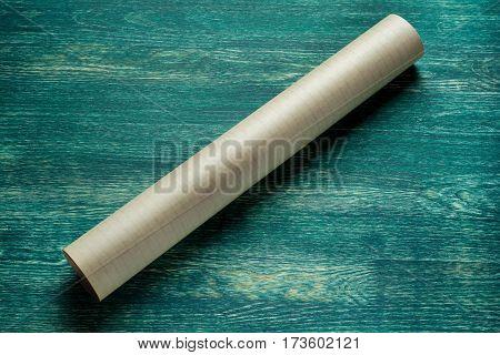 Rolls of blueprintson wooden board. Top view.