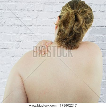 Woman has back and neck pain because of obesity