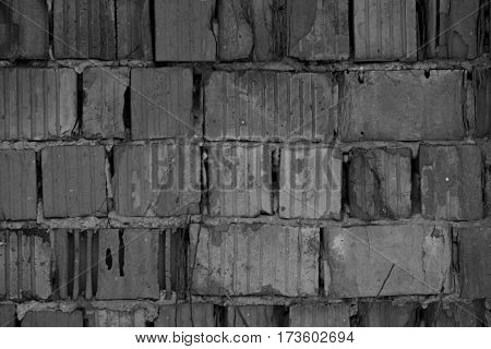Red bricks background, old cracked wall in black and white pattern