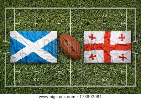Scotland vs. Georgia flags on green rugby field, 3 D illustration