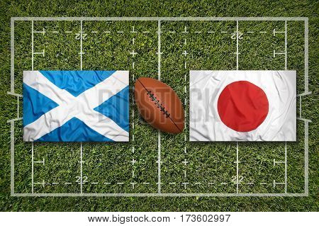 Scotland vs. Japan flags on green rugby field, 3 D illustration
