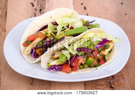 chicken soft taco plate on wood table