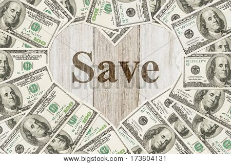 The love of saving money message One hundred dollar bill in the shape of a heart with a weathered wood heart with text Save