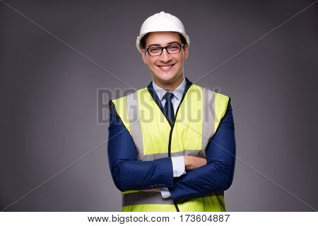 Man wearing hard hat and construction vest