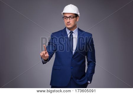 Young architect in industrial concept