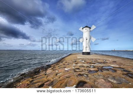 An Old White Lighthouse In Swinoujscie, Poland.