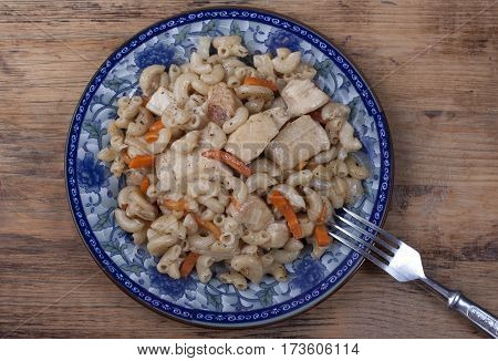 Pasta with chicken and vegetables carrots and onions