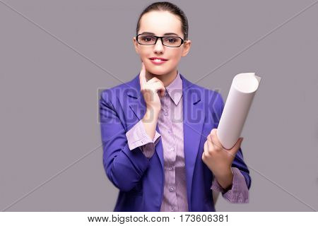 Young woman architect on gray background