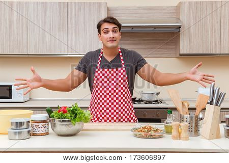 Man male cook preparing food in kitchen