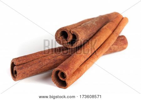 three cinnamon sticks isolated on white background.