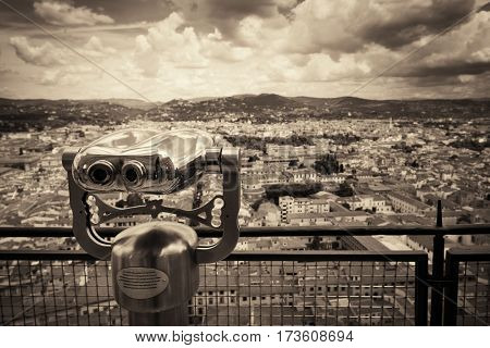 Binocular at top of Duomo Santa Maria Del Fiore in Florence Italy viewed from top of dome.