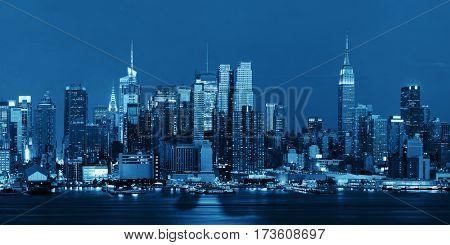 Midtown Manhattan skyline at dusk panorama over Hudson River