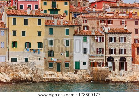 Typical southern europe town with houses standing over the water