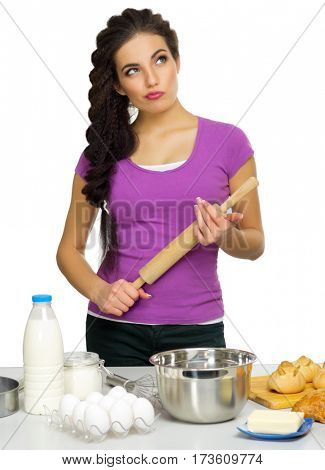 Young woman the chef prepares food isolated