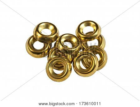 Many brass washers on a white background