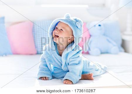 Baby In Bathrobe Or Towel After Bath
