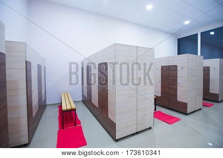 Modern interior of a locker changing room in fitness center gym.