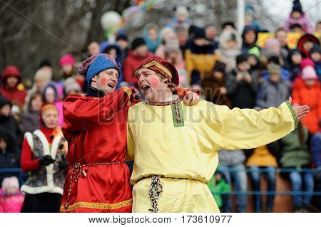 Orel Russia - February 26 2017: Maslenitsa fest. Buffoons Skomorokhs singing closeup