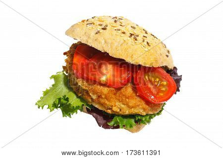 Grain bun with fried pork lettuce and tomatoes isolated