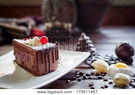 sweet chocolate dessert cheesecake inside with fresh cherries