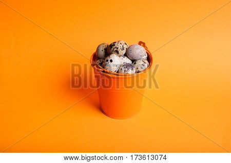 Small Decorative Buckets Filled Quail Eggs On The Orange Background